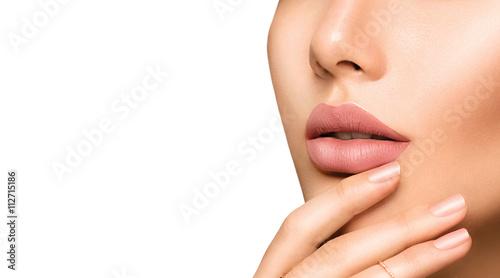 Perfect woman's sensual lips with fashion natural beige matte lipstick makeup Fototapeta