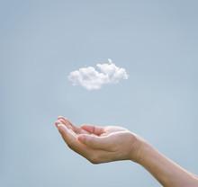 Cloud Computing Concept, Cloud Above Hand Of Businessman