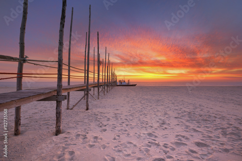 Seaside jetty at sunrise on Texel island, The Netherlands