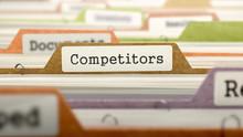 Competitors Concept On Folder Register In Multicolor Card Index. Closeup View. Selective Focus. 3D Render.