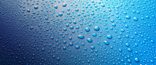 Panoramic Banner Of Water Drops On Blue Metal