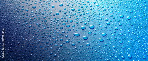 Panoramic banner of water drops on blue metal Fototapet