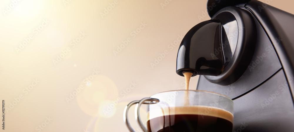 Espresso machine making coffee with beige gradient background