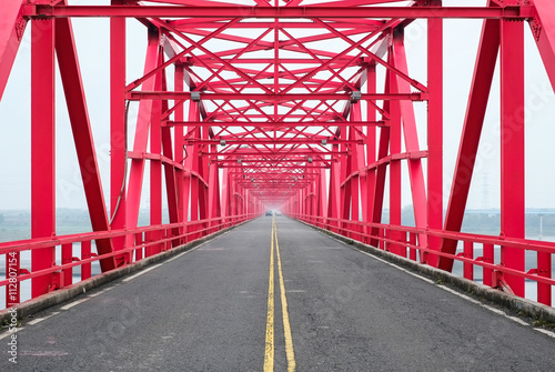Fényképezés  Symmetrical red steel structure construction of bridge and road in Xiluo, Taiwan