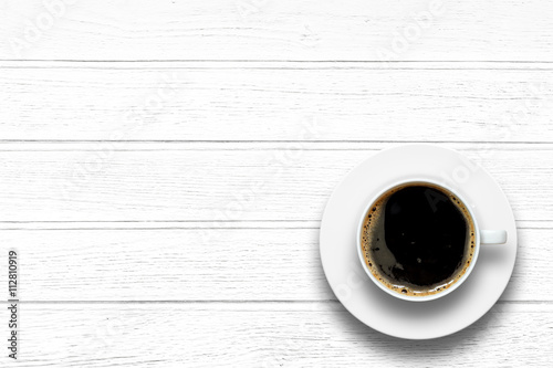 Wall Murals Cafe Top view of coffee cup on a wood background with copy space.