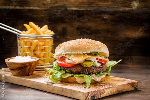 Burger Mit Pommes Auf Holz Buy This Stock Photo And Explore