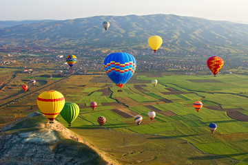 Obraz na Plexi Cappadocia. Colorful hot air balloons flying over the valley at