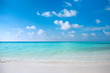 turquoise clear blue ocean water on tropical white sand beach