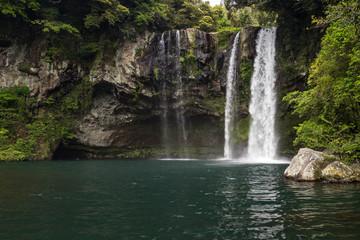 Fototapeta na wymiar Cheonjiyeon Waterfall on Jeju Island in South Korea.