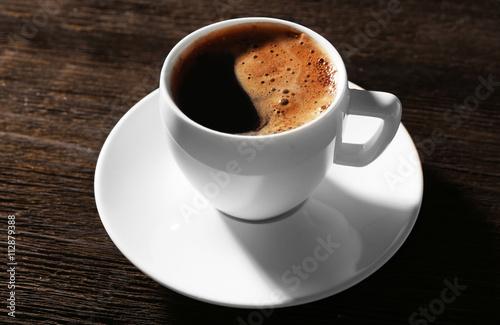 Fotobehang Koffiebonen Cup of fresh coffee on wooden background