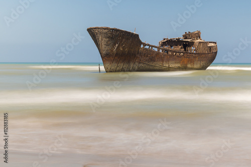 Poster Naufrage Boat aground. Old and rusty ship abandoned on the coast of western sahara. Morocco.