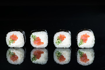 Fototapetaclose-up of sushi with salmon and cucumber on a dark background