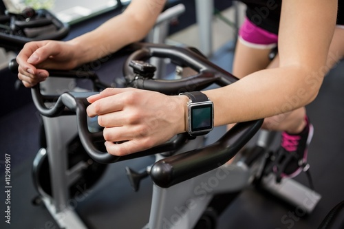 Spoed Foto op Canvas Fitness Woman working out on exercise bike