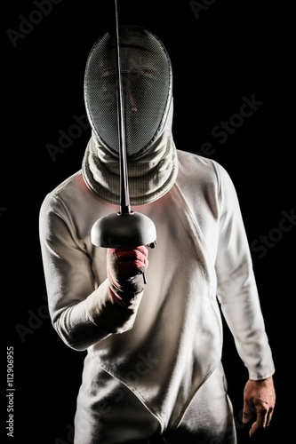 Man wearing fencing suit practicing with sword - Buy this