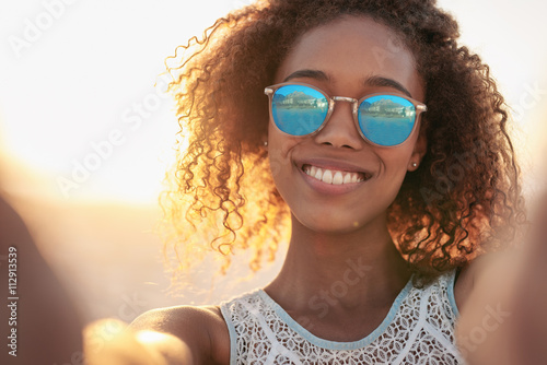 Photo  Sunglasses complete her beach style