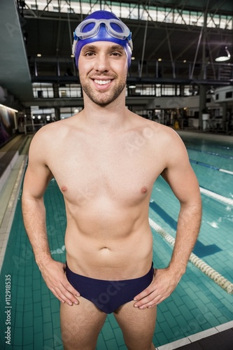 Handsome swimmer standing near pool Canvas Print