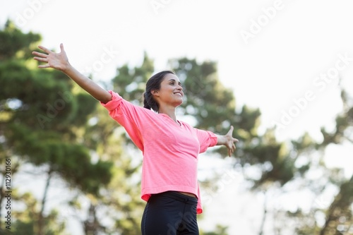 Woman smiling and throwing arms
