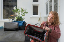 Woman Sitting Quality Checking Leather Holdalls