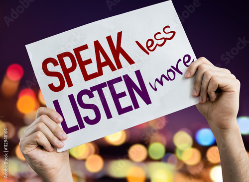 Photo Speak Less Listen More placard with night lights on background