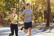 Caucasian Woman And Man Jogging On A Country Road, Close Up