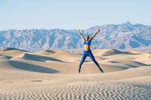 Runner Doing Star Jumps In Desert, Death Valley, California, USA