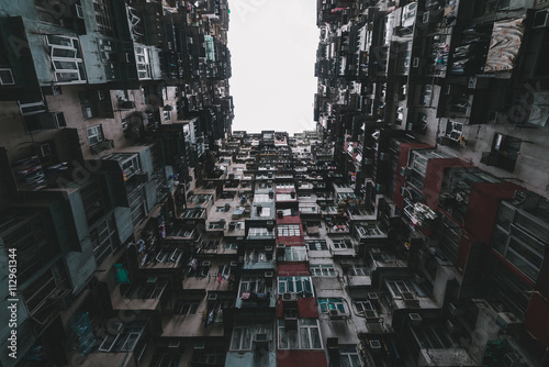 Caged life - Looking up courtyard of extremely dense residential building.