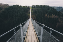 Adventure Bridge - Suspension Bridge Over Forest Canyon.