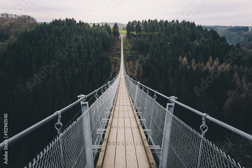 Canvas Prints Bridges Adventure bridge - Suspension bridge over forest canyon.