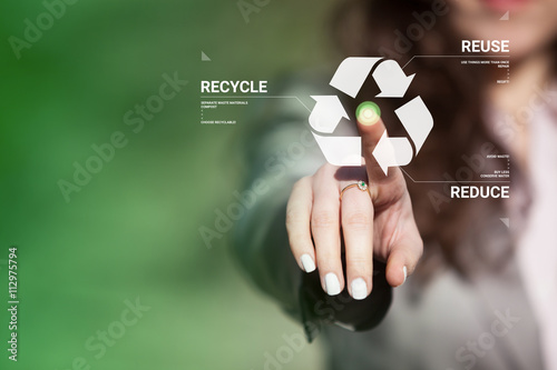 Obraz na plátně  Businesswoman touching recycling symbol on virtual touch screen