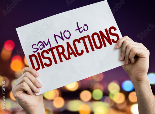 Photo  Say No To Distractions placard with night lights on background