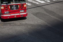 A Fire Truck Moving On Road