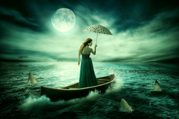 Fototapeta Niebo Young lonely woman with umbrella drifting on boat after storm surrounded by sharks