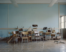 Old, Broken Chairs In An Abandoned School