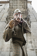 A Man Dressed Up As Sherlock Holmes With A Magnifying Glass Distorting His Eye