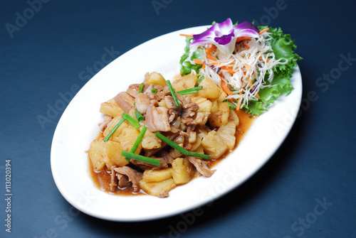Fotografering  Fry pork with pineapple