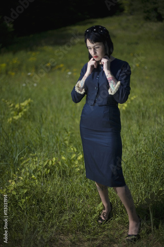 A woman standing in a field