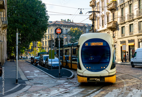 Leinwand Poster  Modern tram on the streets of Milan. Italy.