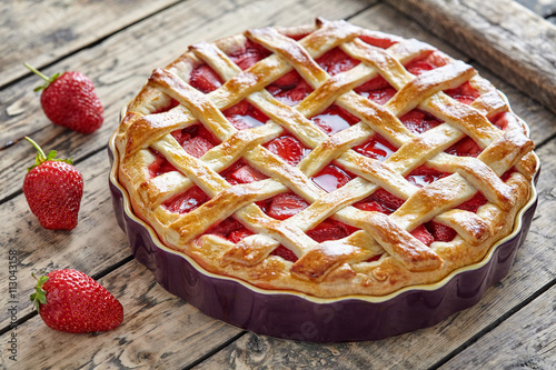 Fotografia, Obraz  Baked strawberry pie cake sweet pastry on rustic wooden table background