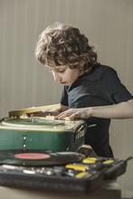 Boy Examining Gramophone At Home
