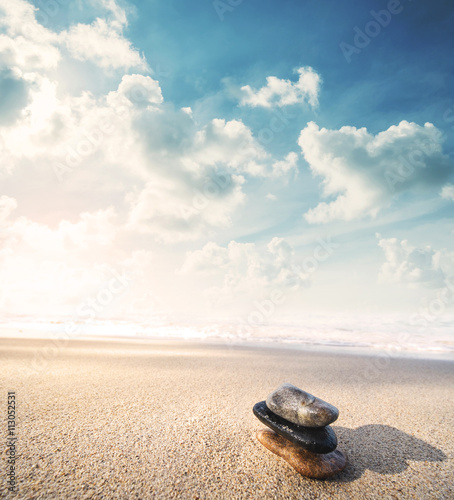 Photo sur Plexiglas Zen pierres a sable Balance stone on the beach in sunrise, vintage tone