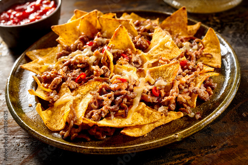 Plate full of nachos and ground beef