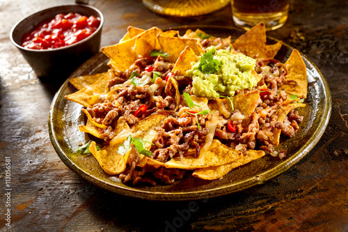 Cuadros en Lienzo Cheese nachos with beef, guacamole and salsa