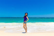 Young beautiful Asian girl on a tropical beach. Summer vacation