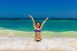 Young beautiful Asian girl with long black hair in bikini, on t