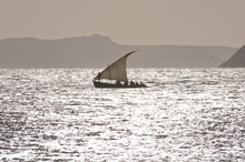 Small Sailing Boat At Sunset Near Diego Suarez (Antsiranana), Madagascar