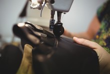 Close-up View Of A Cobbler Using A Sewing