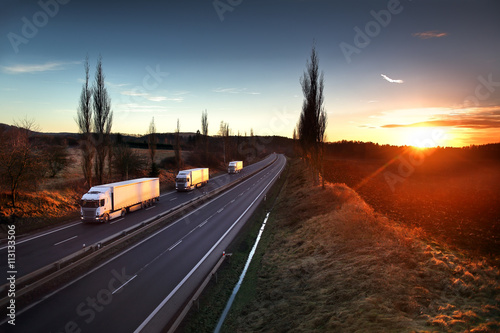 Trucks on the road Fotobehang