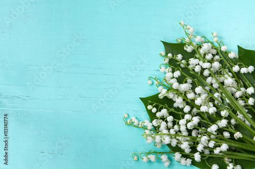 Poster Muguet de mai Bouquet flowers lilies of the valley on a wooden background