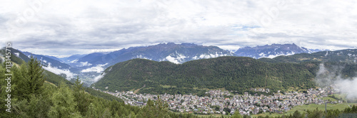 Panoramic view of Aprica town and the Bergamasque Alps Wallpaper Mural