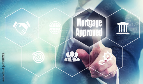 Fototapeta Businessman pushing a mortgage loan concept button. obraz